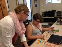 Student and instructor use Play-Doh to create a keypad to play Super Mario Bros.