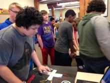 Student uses homemade classic Nintendo controller to play Tetris.